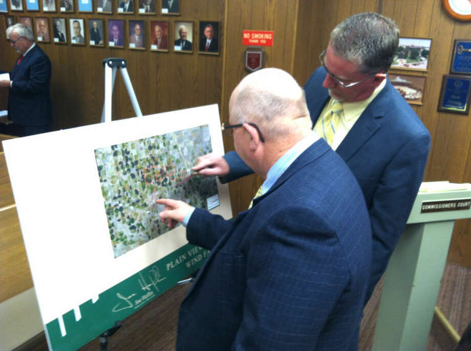 Ryan Crowe/Plainview HeraldCounty Commissioners Benny Cantwell (left) and Harold King study a map showing the proposed area of a new wind farm, to be placed just northwest of the city of Plainview.
