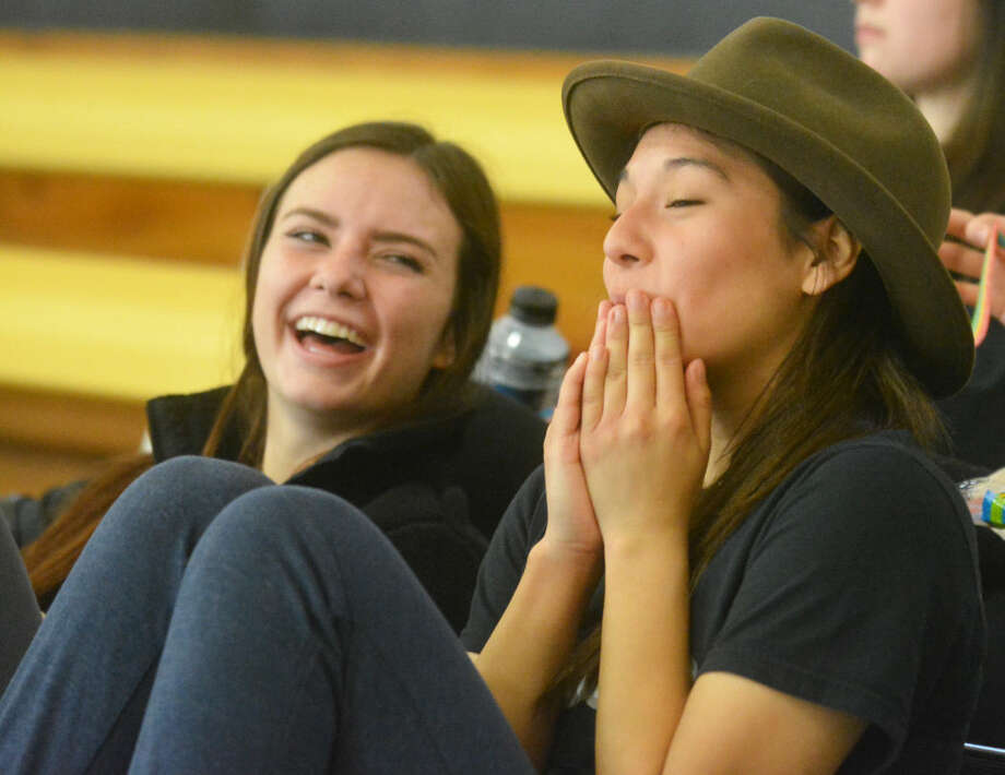 Plainview Christian Academy's Abbey Maresca, left, has a good laugh as teammate Savannah Guzman wears Coach Tom Hall's hat during a break between games of the Cotton Center Tournament. Maresca and Guzman, the only seniors on the team, have been instrumental in leading the young squad to the brink of the playoffs. Photo: Skip Leon/Plainview Herald