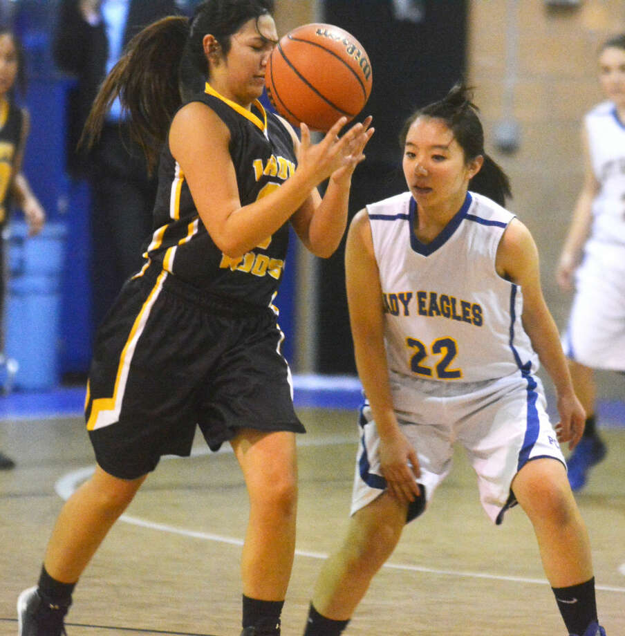 Plainview Christian Academy's Kako Sugae, 22, guards a Kress player during a game earlier this season. The Lady Eagles defeated Amarillo Ascension Tuesday night and can clinch a playoff berth with a victory over Wichita Falls Notre Dame in the their final regular-season game Saturday. Photo: Skip Leon/Plainview Herald