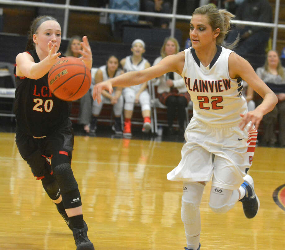 Plainview's Harlee Davis, 22, tries to steal the ball from a Lubbock Cooper player during a game earlier this season. Davis scored a team-high 14 points on 7-of-9 shooting to help the Lady Bulldogs overcome a 15-point halftime deficit and beat Cooper Tuesday to take over sole possession of first place in District 4-5A. Photo: Skip Leon/Plainview Herald