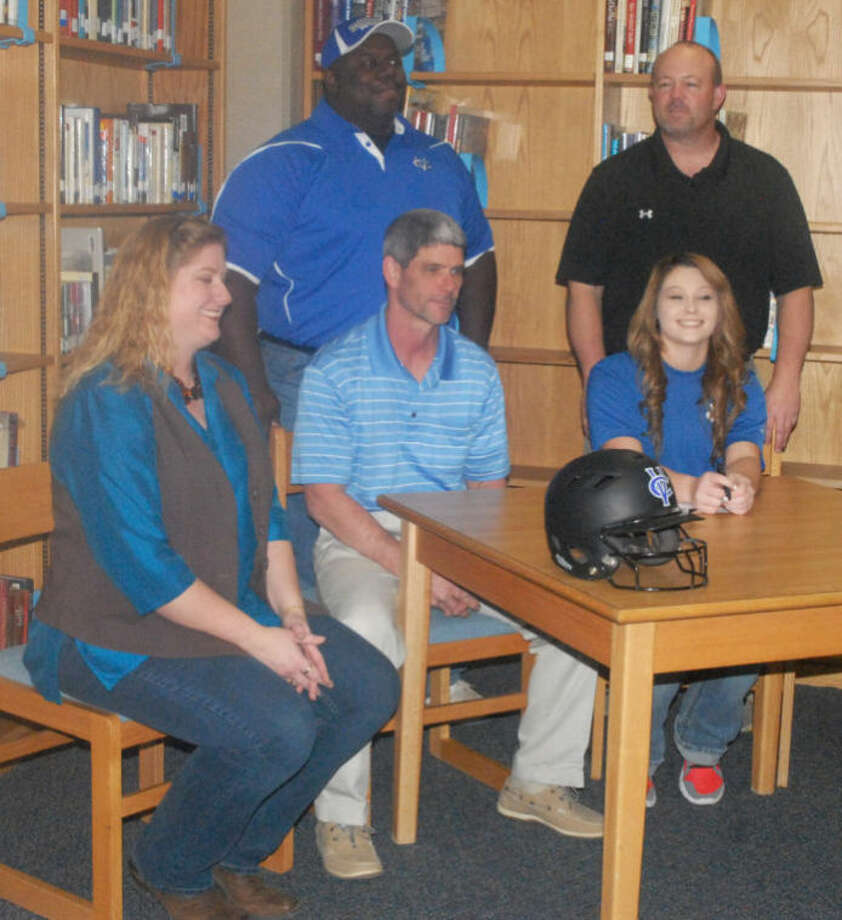 Katie Jackson (seated, right) signed a letter of intent Thursday to play softball at Vernon College. Also seated with the Lockney High School senior are (from left) her stepmom Rachel Petty and Lockney softball head coach Malcolm Moerbe. Standing are (from left) Vernon College softball coach Melvin Jenkins and Randy Jackson, Katie's dad and the assistant softball coach at Lockney. Photo: Skip Leon/Plainview Herald