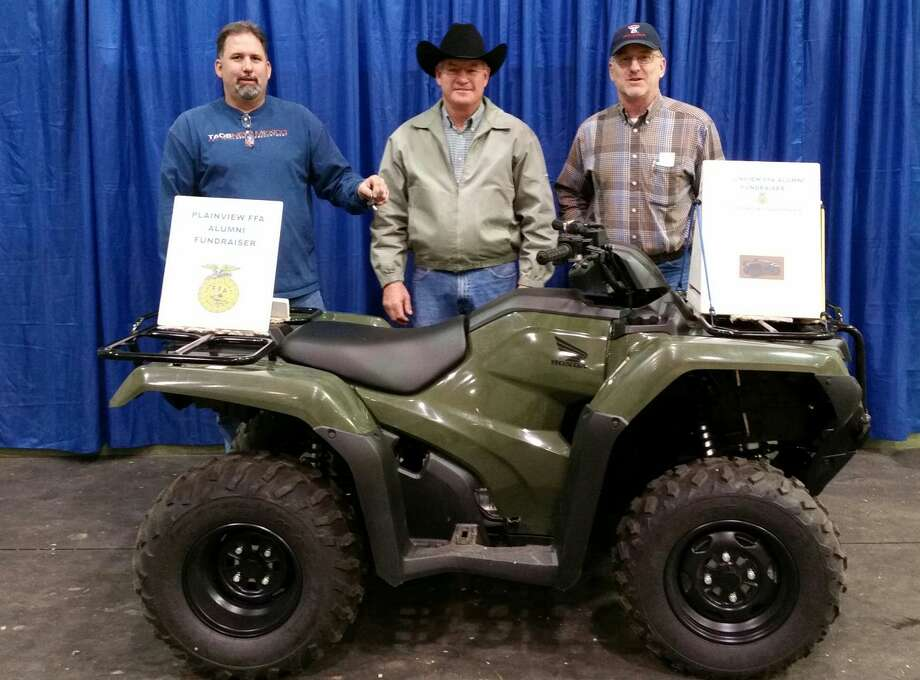 Martin Stoerner of Lockney (center) was winner of a 2015 4WD Honda Rancher raffled by the Plainview FFA Alumni Association (formerly Plainview FFA Booster Club) at the Hale County Stock Show Premium Sale on Monday. Funds go toward FFA scholarships to graduating seniors. Shown with Stoerner are Scott Snipes (left), vice president; and Joe Mustian, president. John Young of Hale Center won second prize, a $100 United Supermarkets shopping spree.