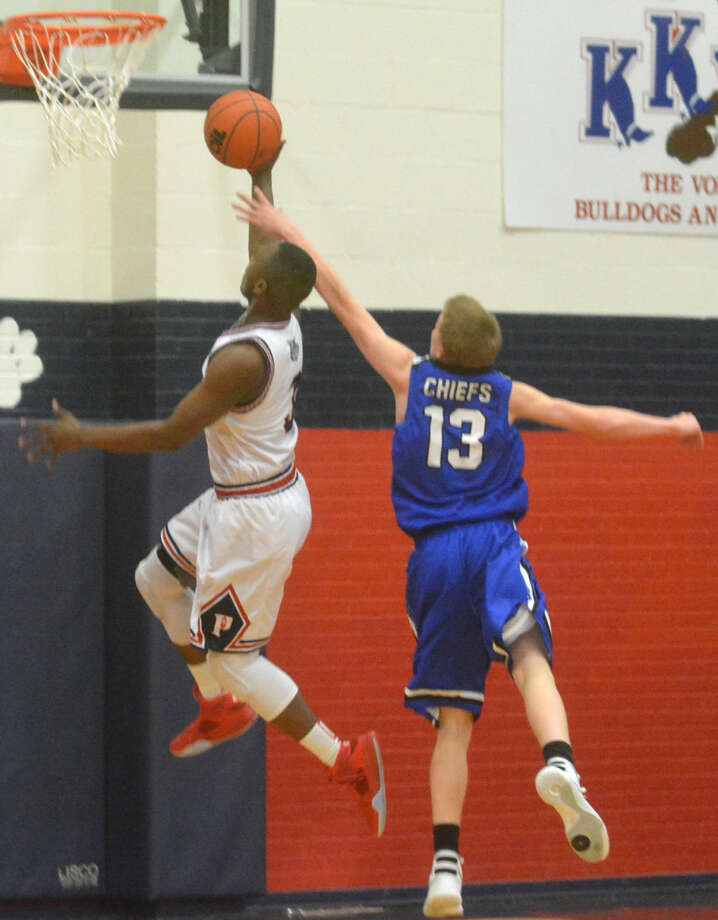 Plainview's Ben McGee scores a layup ahead of a San Angelo Lake View player during a District 4-5A game Friday night. McGee scored 23 points as the Bulldogs turned up the heat in the second half and raced to a 94-51 victory. Photo: Skip Leon/Plainview Herald