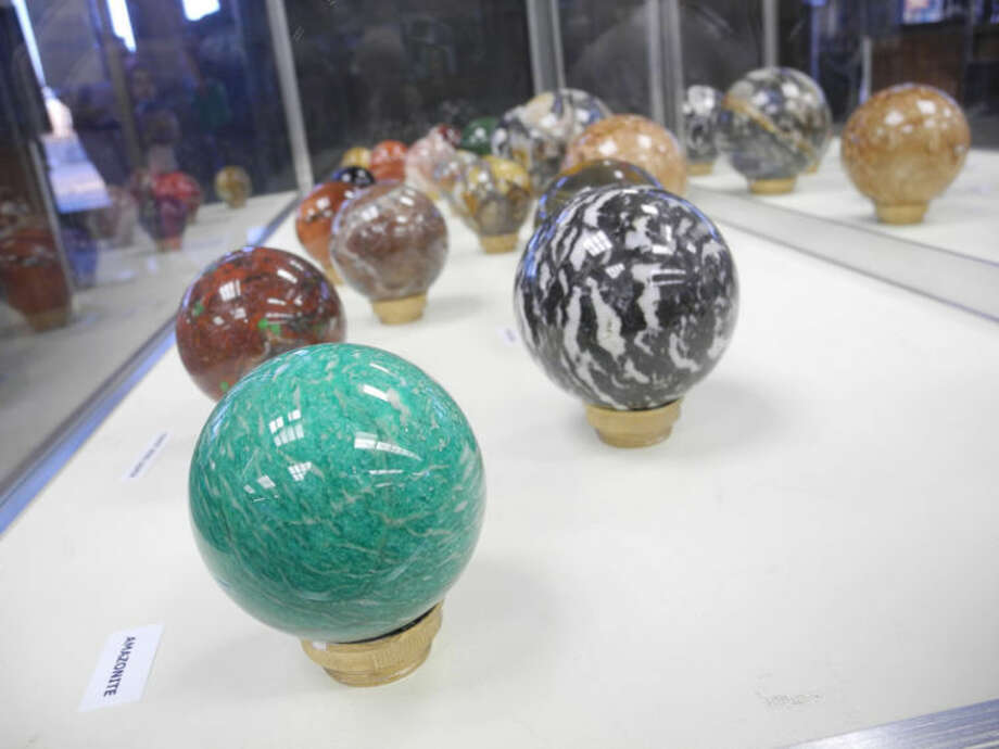 Jim Matlock, a charter member of the Hi-Plains Gem & Mineral Society, cuts rocks into spheres, now on display at Unger Memorial Library. Photo: Gail M. Williams | Plainview Herald