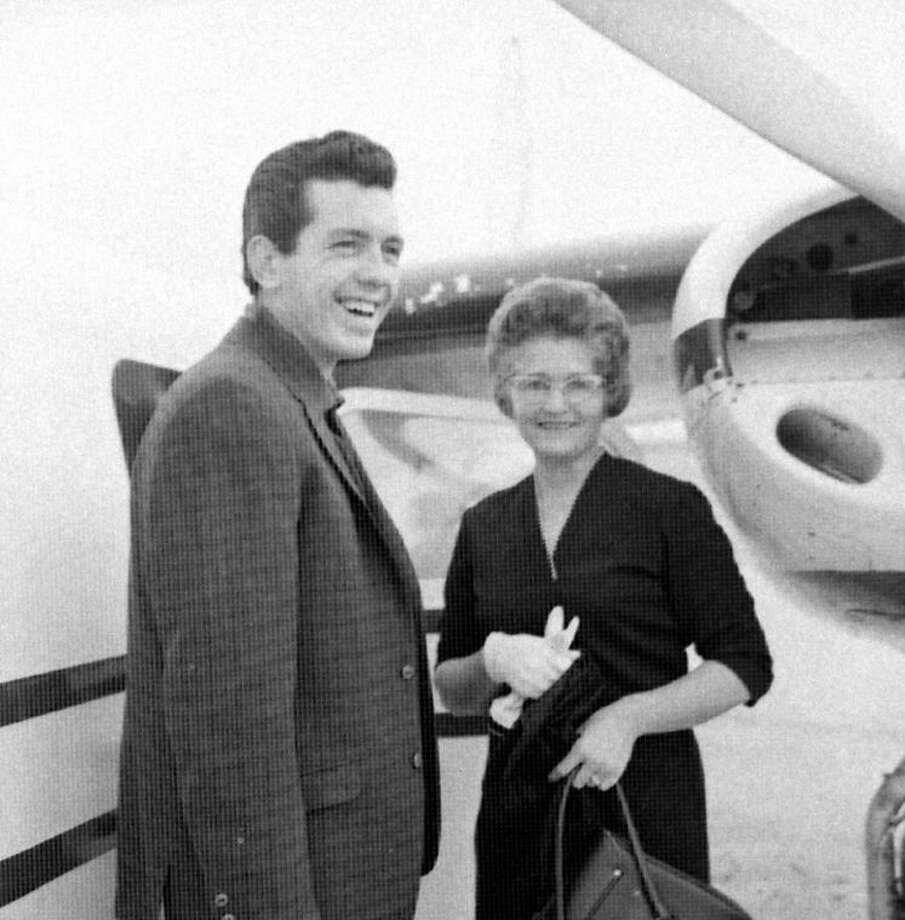 Herald File PhotoKeith McCormack and his aunt, Faye Voss, visit before McCormack's airline departure for New York in January 1964 to attend a banquet honoring songwriters who had major hit records in 1963. McCormack received a special award as the only writer of a song selling more than 1 million singles during the year. Miller Flying Service flew McCormack to Dallas for his airline connection to New York.