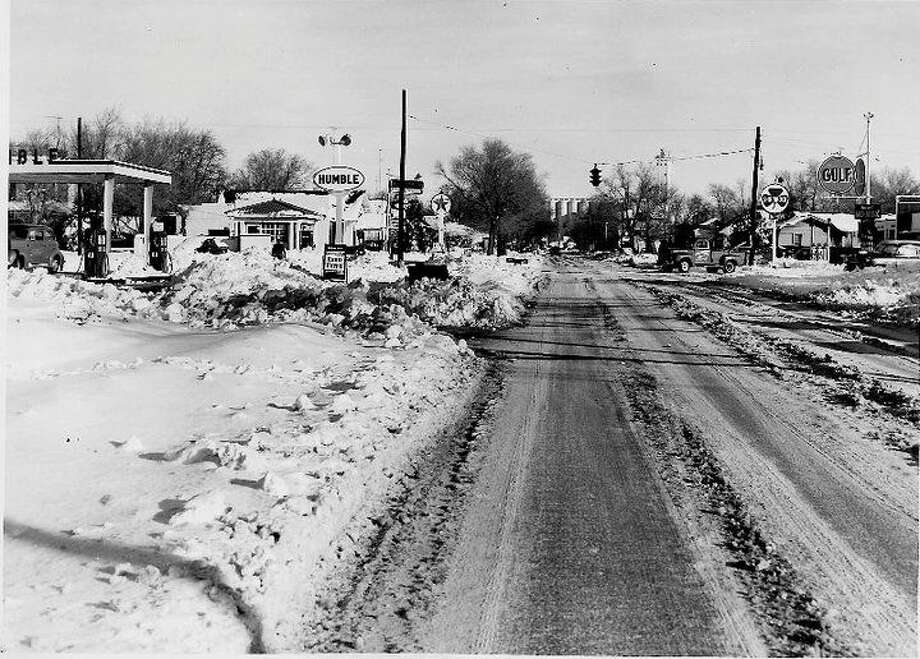 Herald File Photo A photo of the intersection of Seventh and Columbia taken Feb. 6, 1956, shows one of Plainview's major thoroughfares was open to traffic two days after the city's worse blizzard ended. However, most side streets remained blocked by deep snow drifts for days after the 30-inch snowfall occurred.