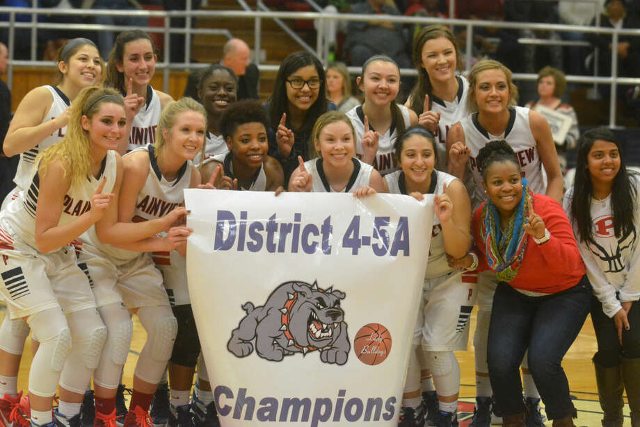 The Plainview girls basketball team celebrates another district championship at the Plainview High School gym Friday night. The Lady Bulldogs clinched their fourth consecutive district crown with a victory over San Angelo Lake View. Photo: Skip Leon/Plainview Herald