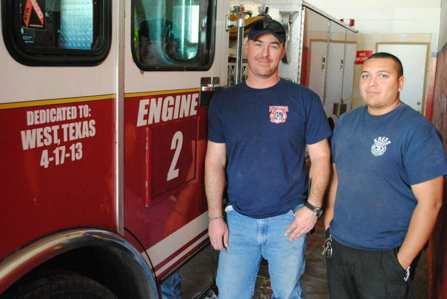 Kress Fire Rescue Chief Kevin Goss and firefighter Ben Rojas stand next to their newest truck, now named Engine 2. The truck bears a dedication to the citizens of West, Texas where an April 17, 2013 explosion killed 15. Photo: Ryan Crowe/Plainview Herald