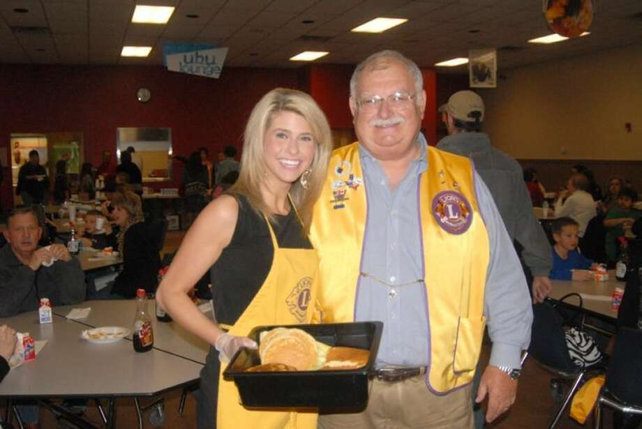 Doug McDonough/Plainview HeraldKLBK-TV Chief Meteorologist Nikki-Dee Ray, shown last year with then-Lions Club President Rusty Ingram, will be back as a guest server today during the annual Plainview Lions Club Pancake Supper. It will be held from 5-8 p.m. in the Plainview High School Cafeteria, in conjunction with the Plainview Bulldogs-Lady Bulldogs double-header basketball game against the Hereford Whitefaces. Cost is $5 per person and tickets are available from any Lions Club member as well as at the door. The menu includes pancakes, bacon, sausage, coffee, milk and orange juice. Also tonight, the PHS Student Council will host a bake sale and silent auction to benefit the Plain view Stars Special Olympics Team. That group will be set up in the gym lobby. Among auction items are various pieces of Texas Tech memorabilia signed by Head Coach Kliff Kingsbury.