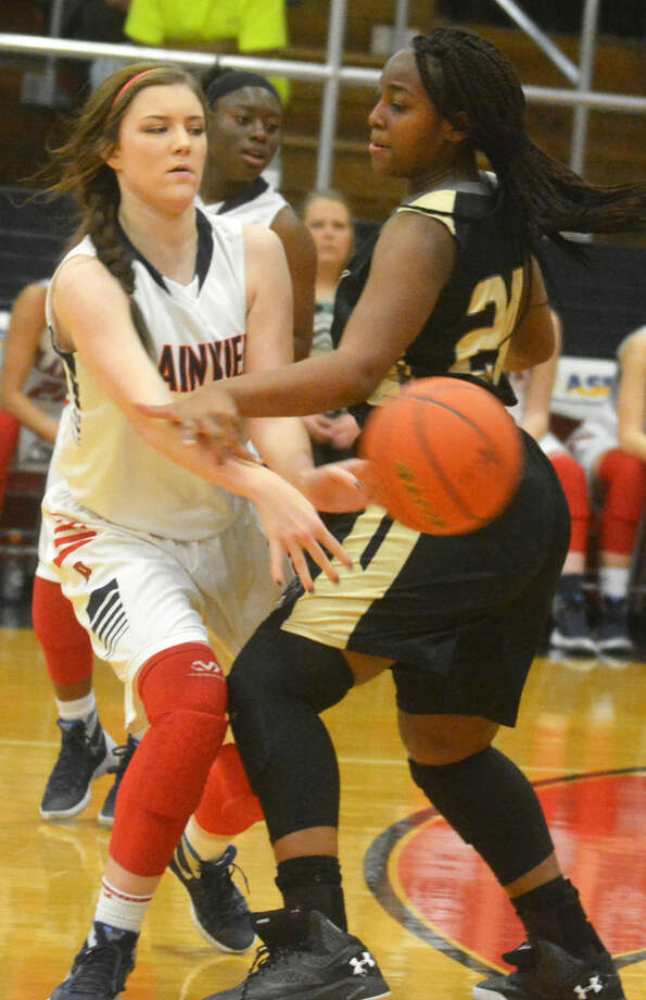 Plainview's Crosslyn Lusk, left, passes the ball against Lubbock High's Clarissa Francis during a game earlier this season. The Lady Bulldogs finished off their regular season with a resounding 70-29 triumph over the Lady Westerners in Lubbock Tuesday. Plainview will play Palo Duro in the bi-district round of the playoffs at 6:30 p.m. this Tuesday, Feb. 16, at Canyon High School. Photo: Skip Leon/Plainview Herald
