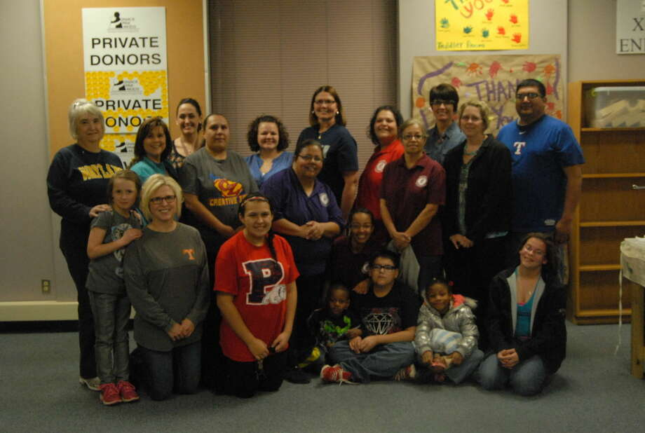 Several Plainview ISD and Head Start staff members lent a hand to Snack Pak 4 Kids on Tuesday as they packed more than 800 snack pack sacks for local students. Photo: Homer Marquez/Plainview Herald
