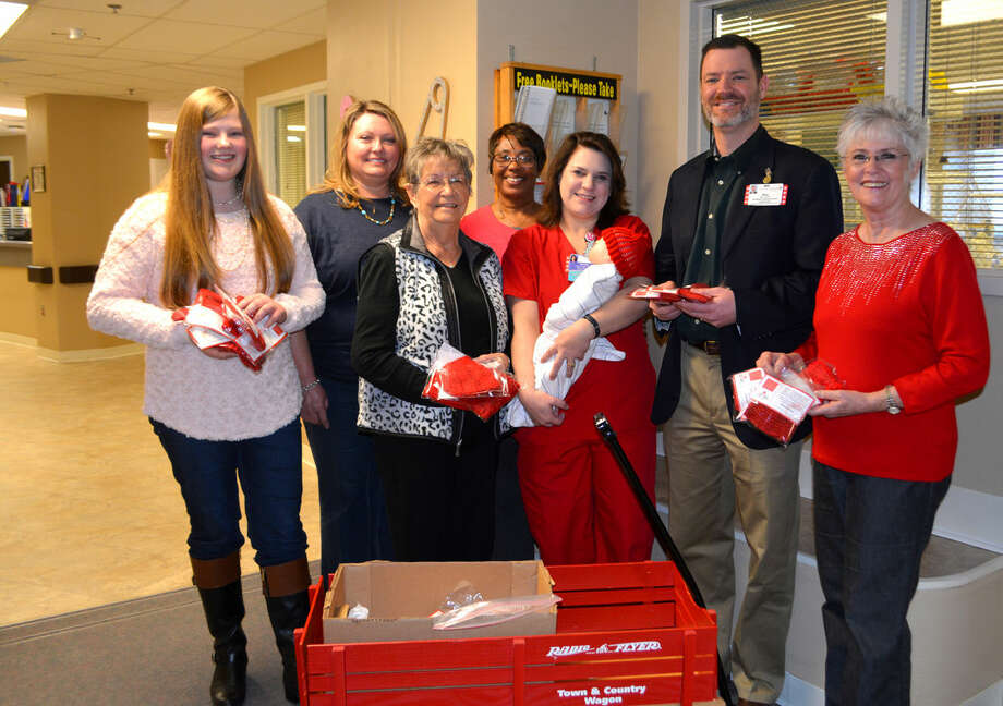 Covenant Health Plainview, along with W.J. Mangold Memorial Hospital in Lockney, have joined the American Heart Association's Little Hats, Big Hearts program with Thursday's delivery of red stocking caps. Each newborn leaving the hospitals in February will be wearing the knitted or crocheted caps through a program that raises awareness of heart disease and congenital heart defects. The caps were delivered Thursday to the third floor nursery at Covenant by volunteer knitters Annabeth Allison (left) and Renee Allison, and accepted by Nell Schurr of Mangold Hospital and Covenant's Sherry Wall, Nurse Manager Michelle Williams holding a training mannequin wearing a red hat, Assistant Administrator Mike McNutt and Andrea Ingram.