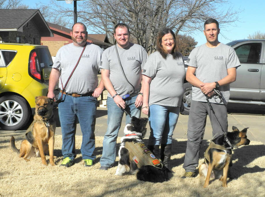 Shown are Josh (left) with Tank, Chris Ankle with Chesty, Angie Nelms, and Felipe Azua with Zoey. Nelms, Military Network Peer coordinator in Plainview, and Azua are among the founders of God's Love And Dogs, or GLAD. Photo: PHOTOS BY GAIL M. WILLIAMS/Herald Correspondent