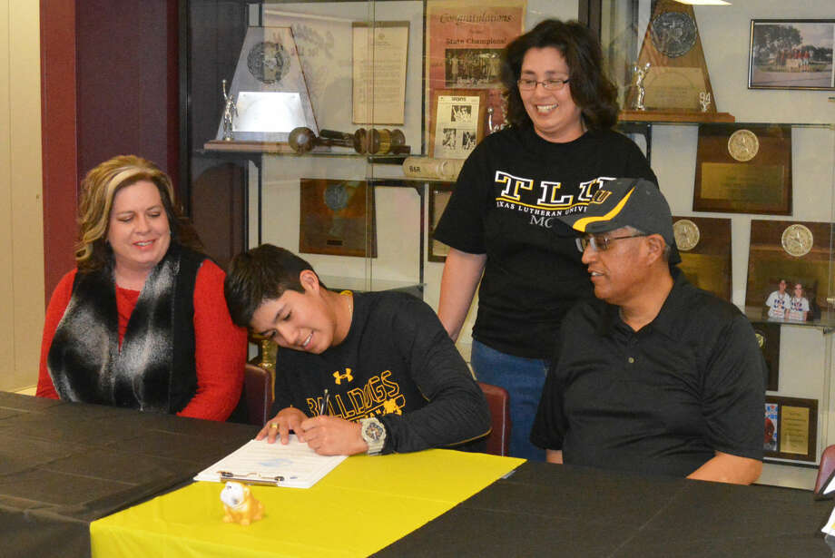 Tulia's Carlos Subealdea, seated center, signs a letter of intent Monday to play tennis at Texas Lutheran University in Seguin. Looking on, seated, are Tulia tennis coach Kim Hoelting, left, and Eddie Subealdea, Carlos's dad. Standing is Michelle Subealdea, Carlos's mom. Carlos has won two state championships and has been state runner-up once during his three years competing for Tulia. Photo: Skip Leon/Plainview Herald