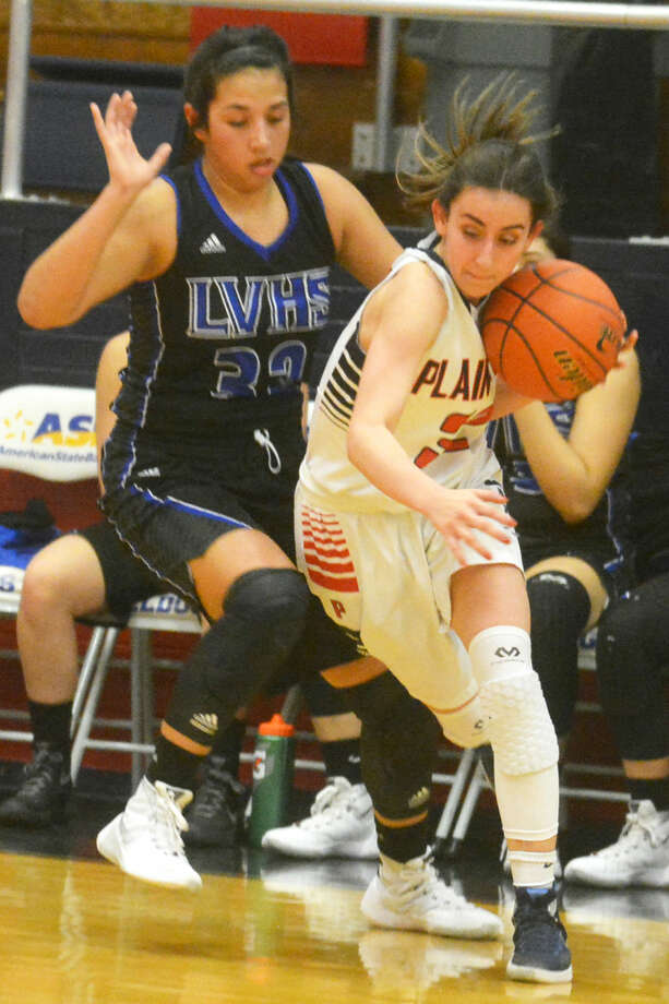 Plainview's Amela Dizdarevic, right, dribbles around a San Angelo Lake View defender during a game earlier this season. The junior has given the Lady Bulldogs a spark since entering the starting lineup for an injured Brittany Rincon in early January. Photo: Skip Leon/Plainview Herald
