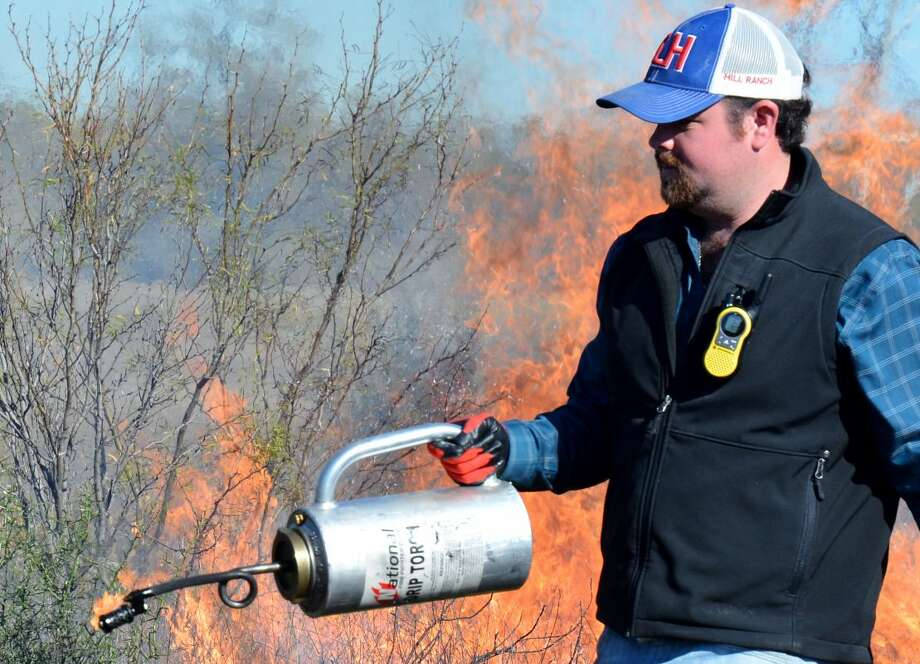 Steve Byrns/Texas A&M AgriLife Communications Houston Dobbins, Texas A&M AgriLife Extension Service agent in Val Verde County, mans a drip torch during a recent prescribed-fire training for AgriLife Extension agents.