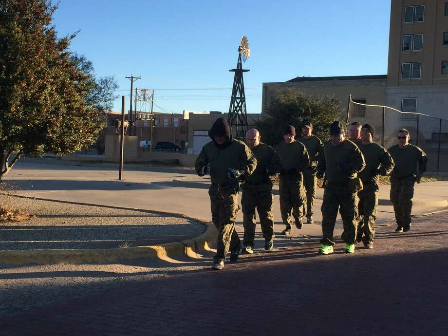 Members of Plainview's re-built SWAT team gets in an early morning run down the streets of the Broadway area Photo: Courtesy Photo