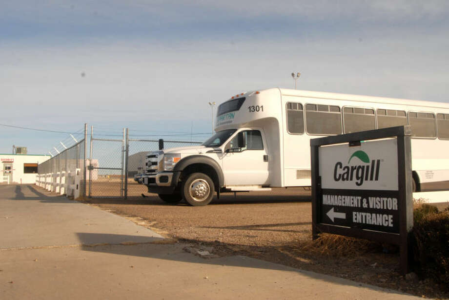 Spartan Transportation buses are used to take a number of local workers from the idled Cargill Meat Solutions plant in Plainview to their daily shifts at a similar Cargill facility in Friona. The local plant went idle Feb. 1, 2013. Photo: Doug McDonough/Plainview Herald