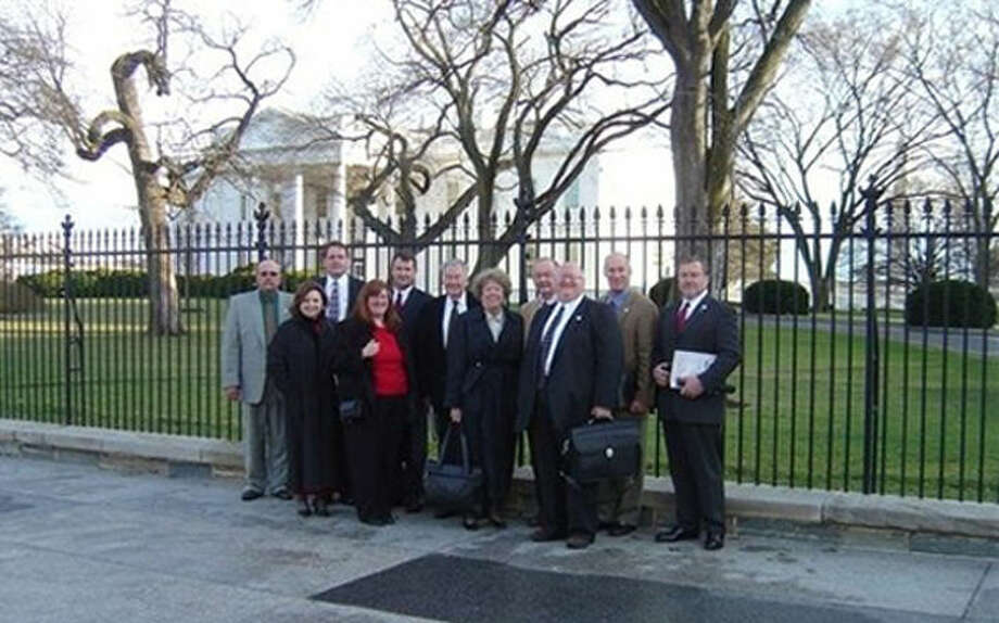 Courtesy Photo A delegation of Ports-to-Plains representatives, including Plainview's John Bertsch (right), gather in front of the White House during a recent trip to Washington, D.C. The coalition is an important lobbying group that seeks state and federal funds to help maintain and expand transportation infrastructure and highways serving the mid-America corridor.