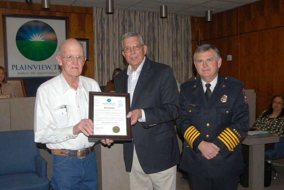 Herman Lindeman (left), owner of Dulaney's Auto Parts, received a special proclamation from Mayor Wendell Dunlap (center) Tuesday for Lindeman's support of providing training tools for Plainview's Fire Department. Also pictured is Plainview Fire Chief Rusty Powers. Photo: Homer Marquez/Plainview Herald