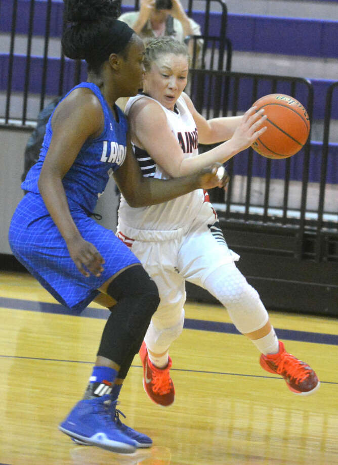 Plainview's Jaden Gonzales tries to drive past a Palo Duro defender during a bi-district playoff game at Canyon High School Tuesday night The Lady Bulldogs' season came to an end with a 61-52 loss. They finish with a 21-11 record. Photo: Skip Leon/Plainview Herald