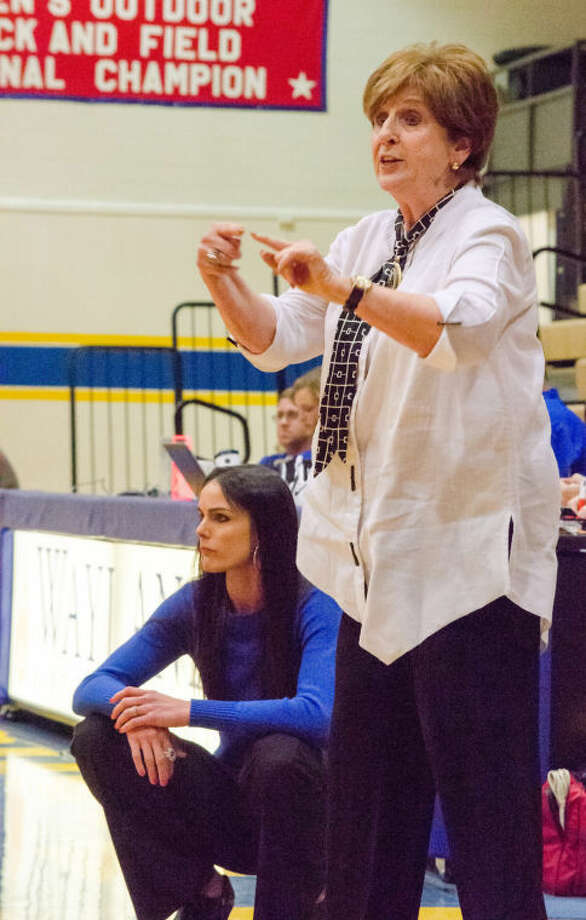 Wayland Baptist Flying Queens assistant coach Melynn Hunt instructs a player while head coach Alesha Robertson studies the action during Thursday night's game in Hutcherson Center. Photo: Photo By Joe Morales