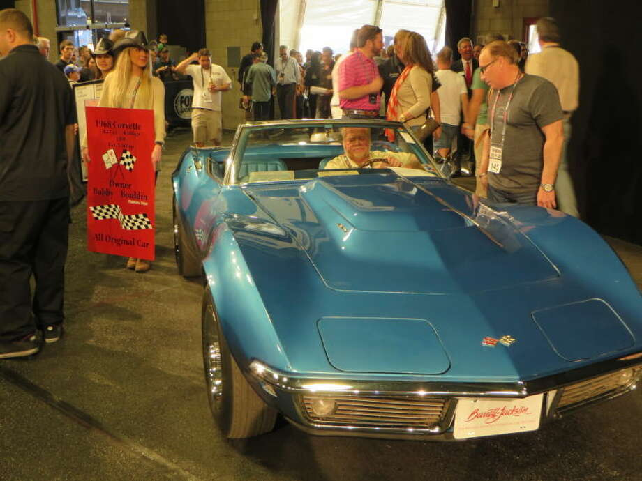 Local car collector, Bobby Bouldin, rolls his 1968 L88 convertible Corvette to the auction block at a recent Barrett-Jackson sale in Scottsdale, Fla. Boudin's rare race car sold for $880,000. Photo: Courtesy Photo