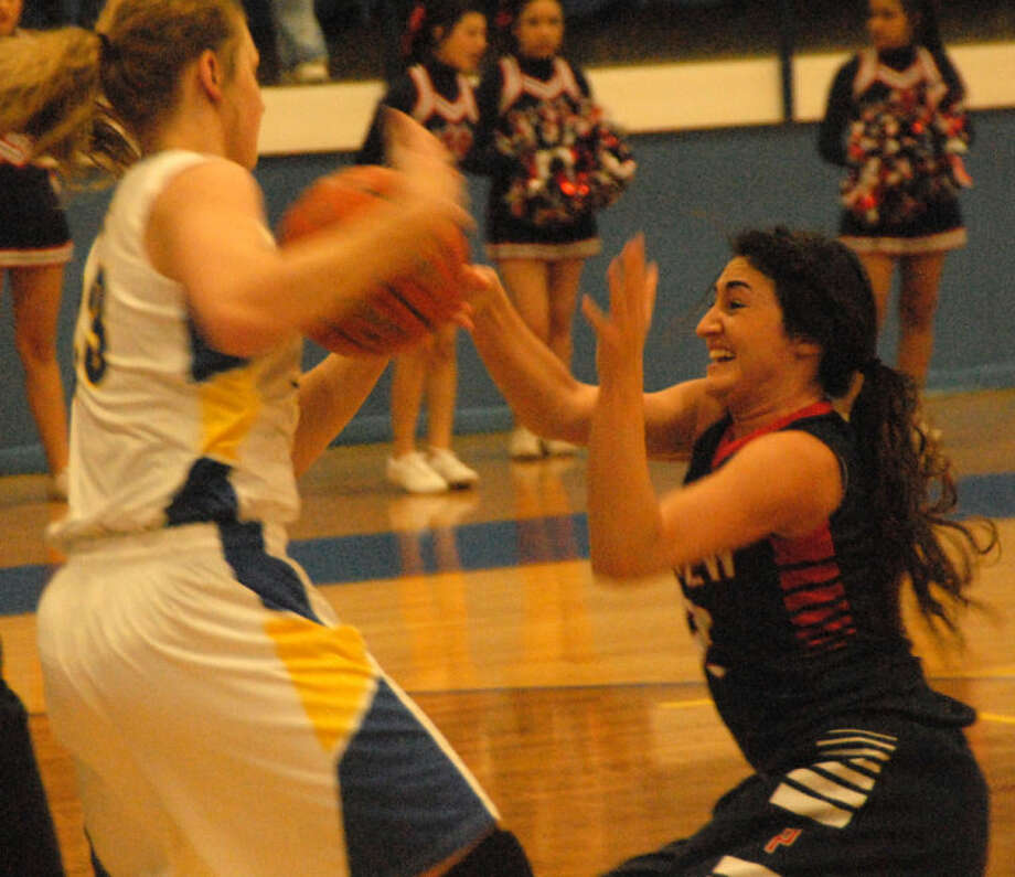 Plainview's Carley Hardage (right) tries to take the ball away from a Frenship player during a District 4-4A girls basketball game in Wolfforth Friday night. Photo: Doug McDonough/Plainview Herald