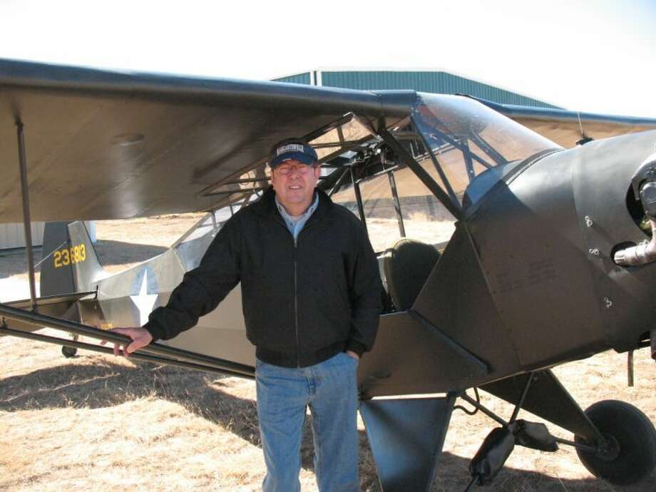 Joe Morris of Canyon is shown with his Piper L-4A which was used at Finney Field in early 1943. Photo: Courtesy Photo