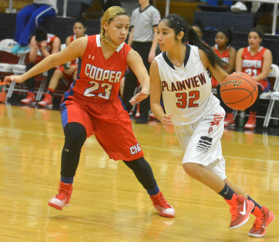 Plainview's Alyssa Gonzalez (right) dribbles against an Abilene Cooper defender during a District 4-5A game this season. Gonzales, a senior, is one of many contributors for the Lady Bulldogs as they have surged to the top of the district with a 4-0 record in the first half of play. Photo: Skip Leon/Plainview Herald
