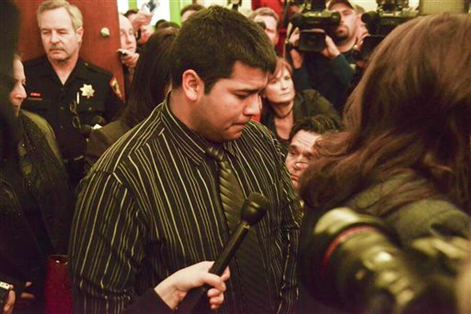 Erick Munoz, husband of Marlise Munoz, is escorted out of court by his attorney Heather L. King, right, Friday, Jan. 24, 2014 in Fort Worth, Texas. The court ruled in Munoz's favor and to remove his brain-dead pregnant wife from life support. Judge R. H. Wallace Jr. issued the ruling in the case of Marlise Munoz. John Peter Smith Hospital in Fort Worth has been keeping Munoz on life support against her family's wishes. The judge gave the hospital until 5 p.m. CST Monday to remove life support. (AP Photo/Tim Sharp) Photo: TIM SHARP / FR62992 AP