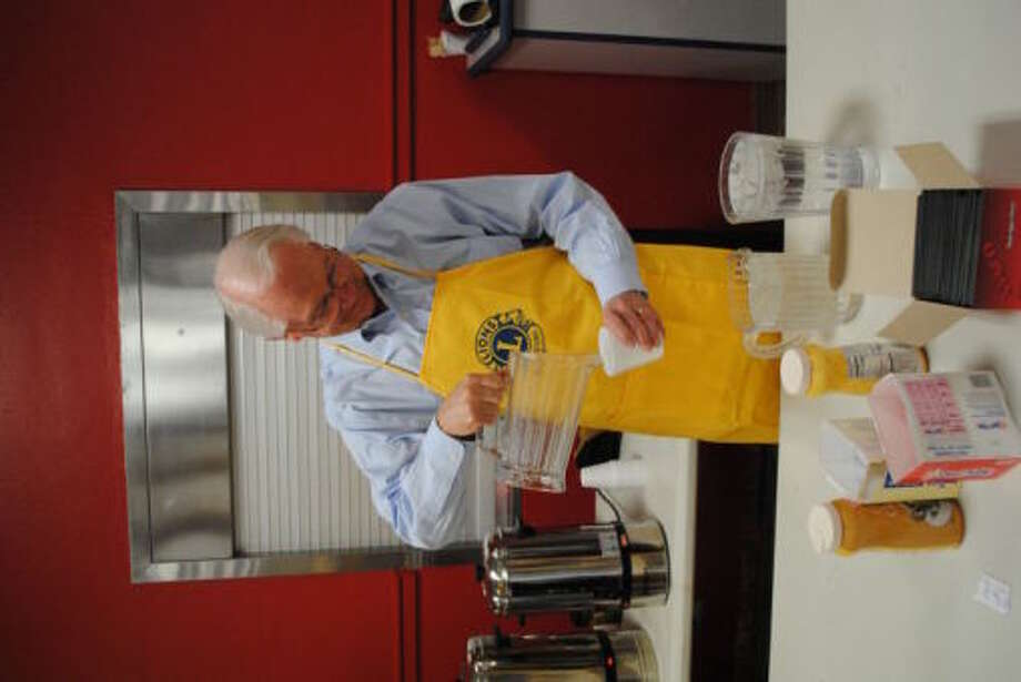 Rep. Randy Neugebauer spent part of his Tuesday night in Plainview, serving drinks during  the Lions Club Pancake Supper at Plainview High School. Photo: Doug McDonough/Plainview Herald