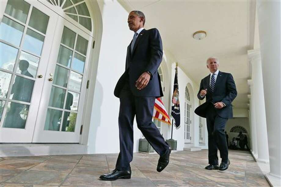 President Barack Obama walks back to the Oval Office with Vice President Joe Biden, right, after making a statement about the crisis in Syria in the White House Rose Garden in Washington Saturday, Aug. 31, 2013. Obama said he has decided that the United States should take military action against Syria in response to a deadly chemical weapons attack. But he said he will seek congressional authorization for the use of force. (AP Photo/Charles Dharapak) Photo: Charles Dharapak / AP