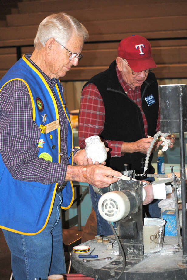 Doug McDonough/Plainview HeraldJim Matlock (left) and Clifford Davis team up to demonstrate the process involved in rock polishing during last year's Hi Plains Gem & Mineral Show. The two are scheduled to be back this weekend for the club's 53rd annual show, set for Saturday and Sunday at the Ollie Liner Center.