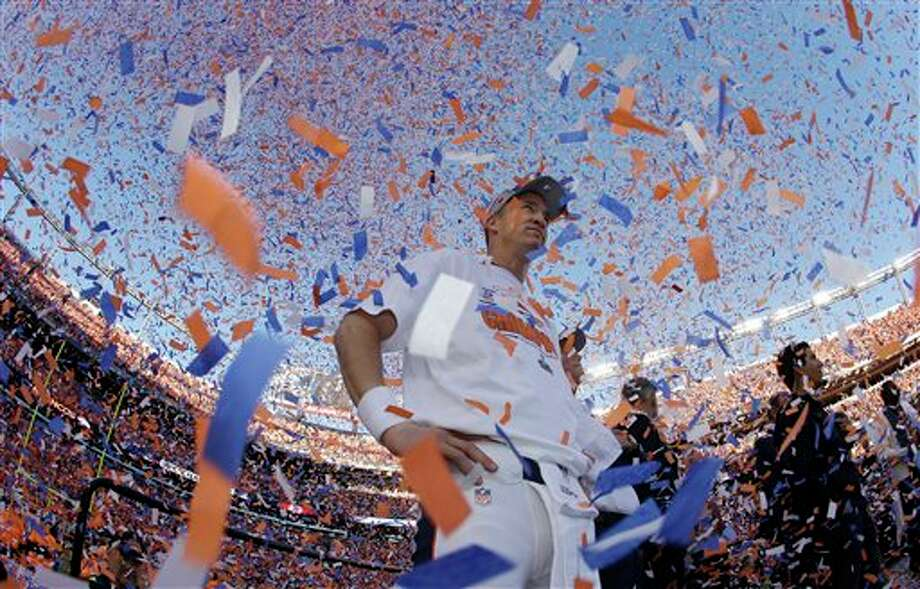 AP10ThingsToSee - Denver Broncos quarterback Peyton Manning is engulfed in confetti during the trophy ceremony after the AFC Championship NFL playoff football game in Denver, Sunday, Jan. 19, 2014. The Broncos defeated the Patriots 26-16 to advance to the Super Bowl. (AP Photo/Charlie Riedel, File) Photo: Charlie Riedel / AP