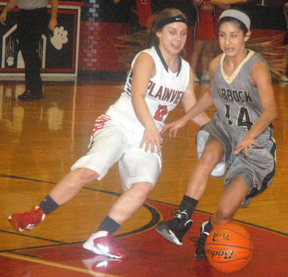Plainview's Jaden Gonzales (left) knocks the ball away from Lubbock High's Alyssa Gonzales during a girls basketball game earlier this season. The teams played Tuesday night in Lubbock with Plainview prevailing 51-34. Jaden Gonzales scored a team-high 12 points, including 10 during a key Lady Bulldogs streak in the third quarter. Photo: Skip Leon/Plainview Herald