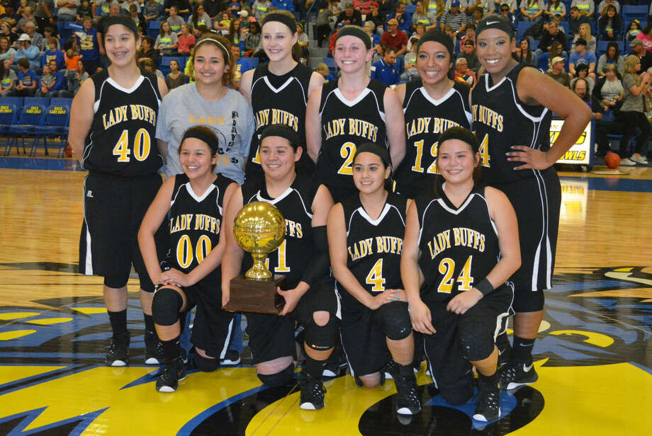 The Petersburg girls basketball team displays the gold ball they earned for winning the area championship with a 46-40 victory over Spur at Hale Center High School Friday night. The Lady Buffs will play district rival Lorenzo in the regional quarterfinals Tuesday. Photo: Skip Leon/Plainview Herald