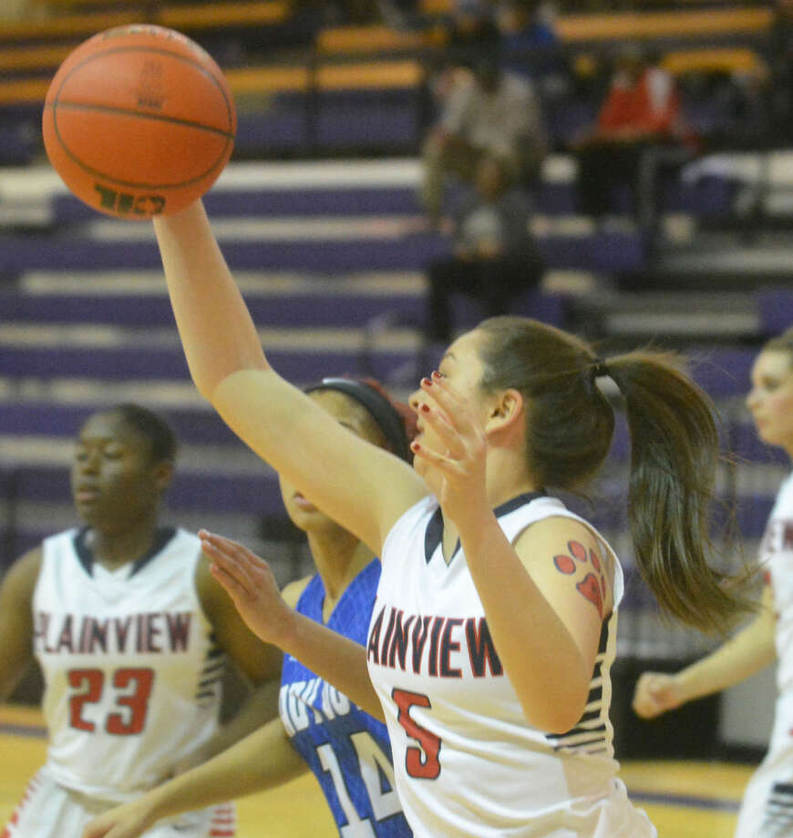 Plainview's Taryn Garza grabs a rebound against Palo Duro in a bi-district playoff game. Garza will be one of six varsity players this year who will return next season, when the Lady Bulldogs enter the tough District 3-5A. Photo: Skip Leon/Plainview Herald