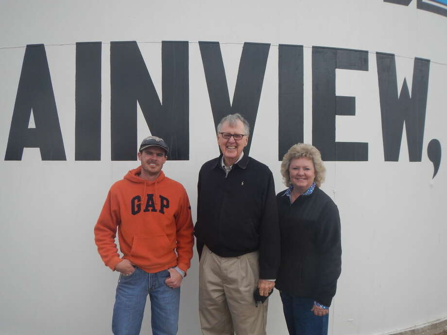 Courtesy PhotoMarking their new partnership, J.B. Roberts (right) and Beverly Wall (center) stand next to Justin Stark, plant manager for Panhandle Compress.
