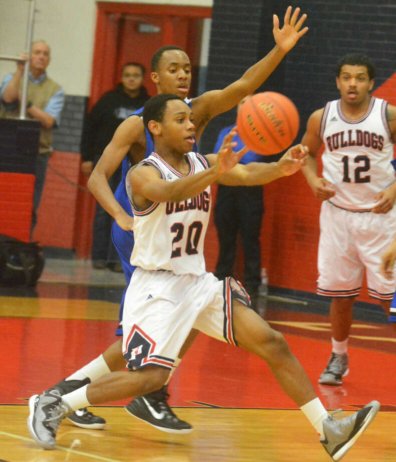 Plainview's Carlton Searcy makes a pass during a District 4-5A game earlier this season. The Bulldogs lost at Abilene Cooper Friday night in a battle for first place in the district. Photo: Skip Leon/Plainview Herald
