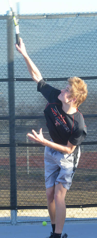 Tulia's Jaxton Hoelting serves during a Hornets tennis practice. The junior is one of three returning state champions for Tulia. Last year he teamed with Carlos Subealdea to win the Class 2A boys doubles state title. Photo: Skip Leon/Plainview Herald