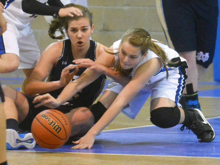 Plainview Christian Academy's Kylee Hill (right) battles Notre Dame's Alex Parkey for a loose ball on the floor during PCA's TAPPS District 1-2A basketball game at PCA Saturday afternoon.  Photo: Skip Leon/Plainview Herald