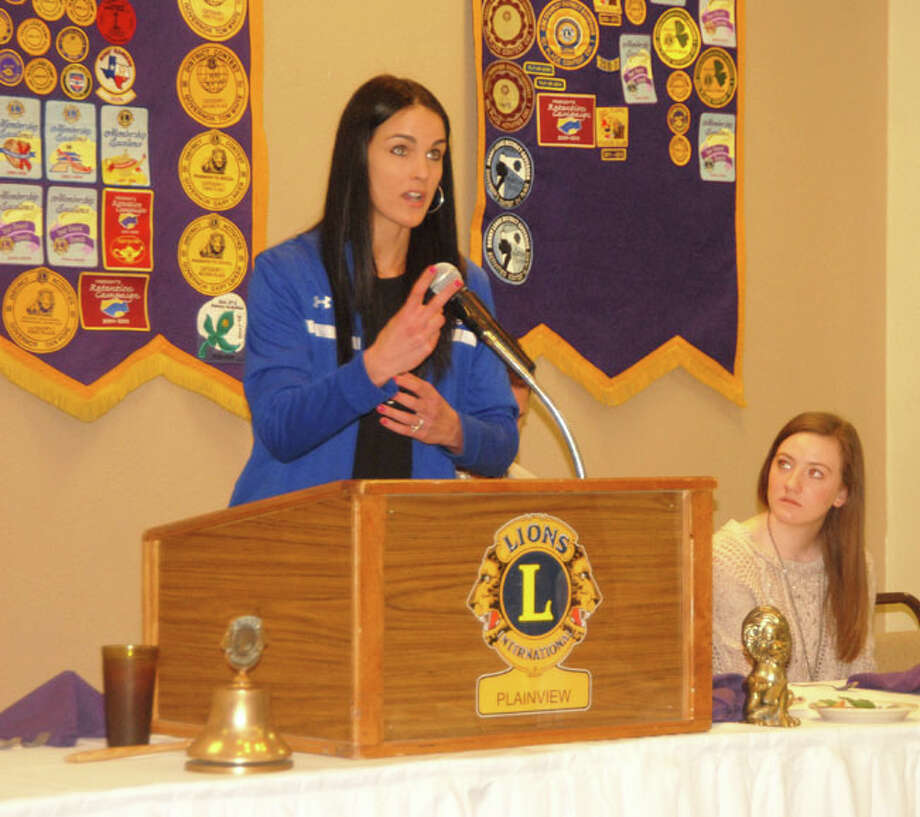 Doug McDonough/Plainview HeraldPlainview Lions Club Queen and Plainview High Lady Bulldog Meredith McDonough listens intently to Wayland Flying Queens Coach Alesha Robertson who presented the program for the Lions on Wednesday. Robertson, the Queen's 13th coach, said the only other time she attended a Lions Club meeting was as a Lions Club queen candidate in high school. The Flying Queens are in their 65th season and the most successful collegiate girls program in the nation with a record 1,516 victories and 10 national championships.