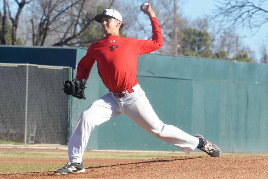 Plainview's Avery Alvarez fires a pitch during a scrimmage earlier this month. Alvarez will be one of many pitchers who will see action for the Bulldogs when they open their season Thursday with a doubleheader in El Paso. Photo: Skip Leon/Plainview Herald
