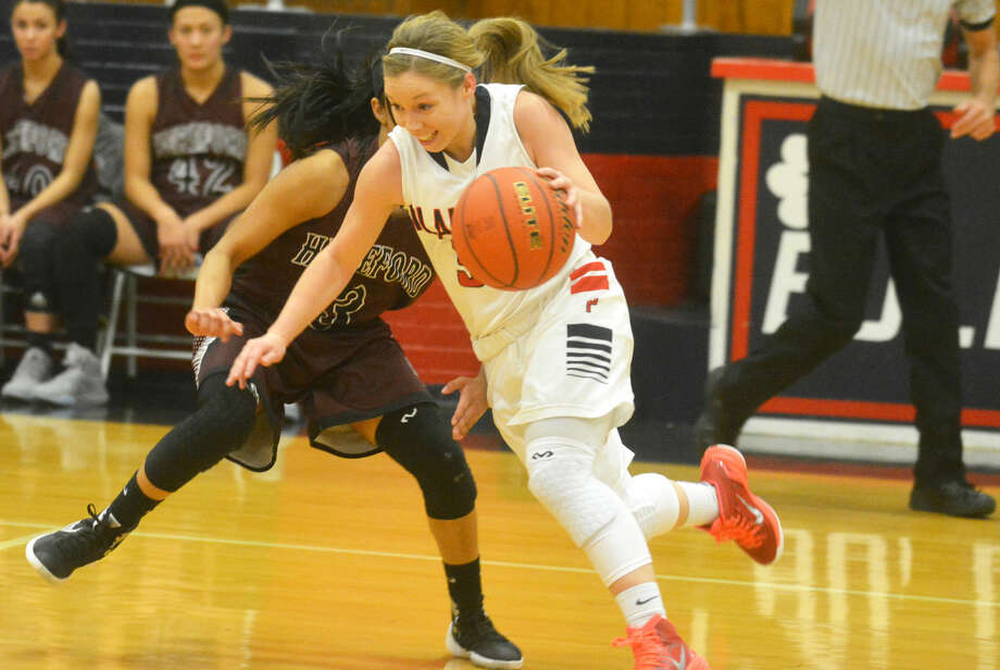 Jaden Gonzales, shown driving past an opponent during a game this season, was voted the District 4-5A Player of the Year. She averaged 16.1 points per game and helped the Lady Bulldogs to the district title with an 8-0 record. Photo: Skip Leon/Plainview Herald