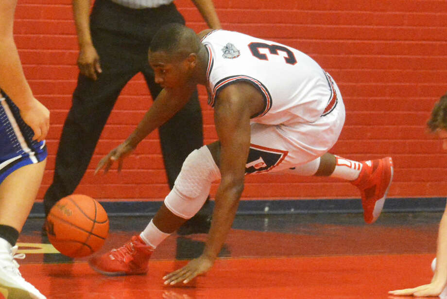 Plainview's Ben McGee scrambles after the ball during a game earlier this season. The 6-foot-1 senior is the leading scorer for the Bulldogs, who will take on El Paso Bel Air in the area round of the playoffs at 5 p.m. Friday at Monahans. Photo: Skip Leon/Plainview Herald