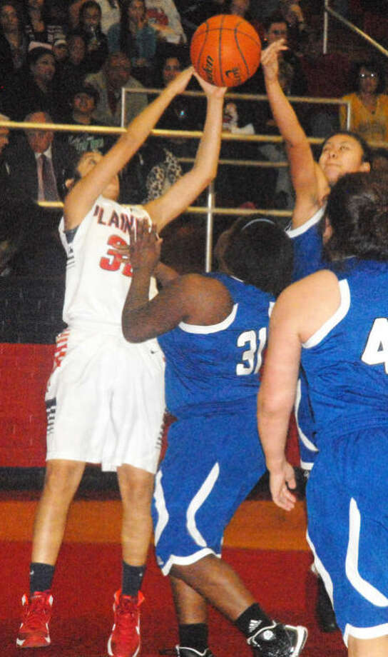 Plainview's Alyssa Gonzales (left) outrebounds two San Angelo Lake View players during a girls basketball game in Plainview earlier this year. The Lady Bulldogs defeated Lake View in San Angelo Friday night and that, coupled with Lubbock Monterey's victory over Frenship, vaulted Plainview into first place in District 4-4A with one game remaining. Photo: Skip Leon/Plainview Herald