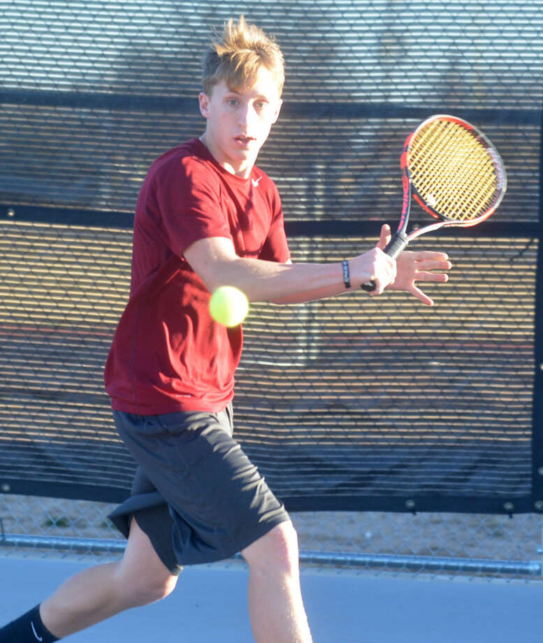 Tulia's Tanner Hooper concentrates on his backhand during practice recently. Hooper, a junior, is one of three returning state champions for the Hornets. He teamed with now-graduated Madison Hoelting to win the Class 2A mixed doubles state title at College Station last year. Photo: Skip Leon/Plainview Herald