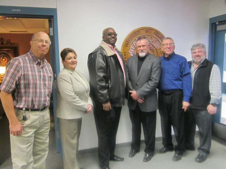 Region 5 Chaplain David Schlewitz, Assistant Warden Arlene Franco, Warden Charles McDuffie, State Director Larry Miles, Dr. Lester B. Griffin, and Wheeler/Formby Chaplain Mike McCreight pose for a picture after touring the progress of the new chapel being built at Plainview's Formby Unit. Photo: Courtesy Photo