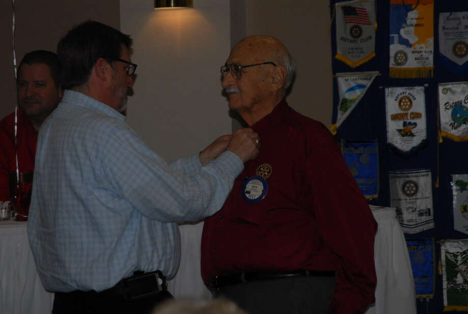 Above, former preacher, Max Browning, received his seventh grade on his Pall Harris pin at Tuesday's Rotary Club meeting at the Plainview Country Club. Photo: Homer Marquez/Plainview Herald